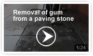 Removal of gum from a paving stone